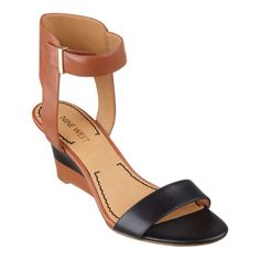 A comfortable ankle strap tops a multi-colored, open-toe wedge sandal that flaunts a sleek silhouette. Adjustable buckle closure. Padded footbed for all-day comfort. Leather upper. Man-made lining and sole. Imported. Multi-colored stacked  2 1/2 inch heels. Women's shoes. Open-toe sandals.