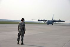An Airman from the 86th Airlift Wing, Ramstein Air Base, Germany, directs a U.S. C-130J Super Hercules aircraft taxiing in from flying a training mission with the Polish armed forces at Powidz Air Base, Poland, April 3, 2014. Three C-130J and more than 100 U.S. personnel will train to strengthen partnership capacity for real-world NATO opersations until April 12 at the U.S. Aviation Detachment. There are two more scheduled Av-Det rotations this fiscal year. (USAF 2nd Lt.Katrina Cheesman)