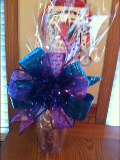 Insulated cup full of goodies with a handmade bow - perfect surprise for a friend at Christmas!