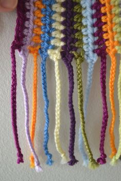 Crochet in Color: Scrapadelic Scarf  Add two 12 inch strips of matching colors, attaching them to each row. Braid each set.