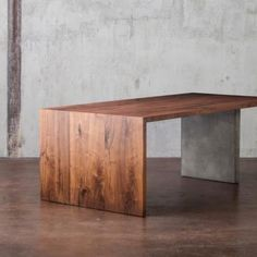 Love this waterfall edge wood and concrete dining table from CustomMade