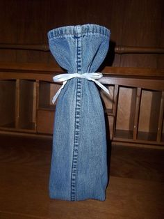 Wine Bottle Cover, denim & a different bow  (I would use part of an old belt as a tie.)