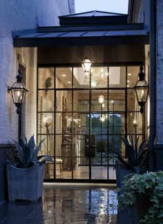 Steel Doors + Copper Lights! #bevolo French Quarter lantern with London Top and London Bottom | #gaslights | #exteriorlighting