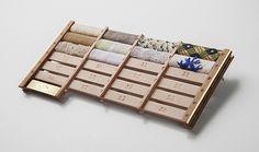 Elvira H. Mateu  Brooch: Condecoración al Ciudadano Hipotecado Medio 2012  Pine wood strips for modelling, brass, textiles  6.5 x 13.5 x 1.4 cm