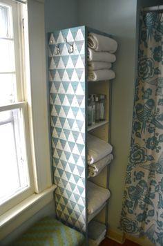 Use paint stirrers to decorate a boring set of Ikea shelves. www.ciburbanity.com