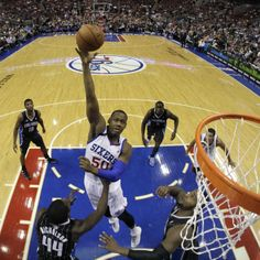 Philadelphia 76ers  Lavoy Allen (50) goes up for a shot between Orlando  Magic s a4afd1b37