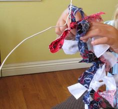 My Granddauhter working on a Rag Wreath for the 4th of July