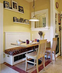 love the white and picture frames above different color cushion and this would be perfect small dining room