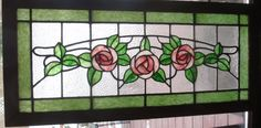 Large roses on a clear textured background in this early 20th century stained glass window Re-framed in oak Dimensions  17 x 37