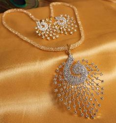 Gorgeous royal cz peacock pendant set with zircon stones filled chain