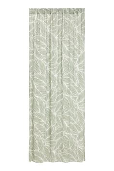 Dusky green. Two curtain panels in cotton and polyester voile with a printed pattern. Wide, cased heading. Hemming tape included.