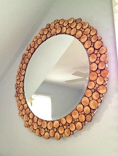 chopped up branches around a mirror. @K D Eustaquio Charie this reminded me of your fireplace idea.