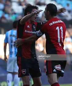 Mauro Formica, of Newell's Old Boys, (L) celebrates with teammate Maximiliano Rodriguez, of Newell's Old Boys, after scoring during a match between Racing Club and Newell's Old Boys as part of Torneo Primera Division 2016/17 at Presidente Peron Stadium on November 05, 2016 in Avellaneda, Argentina. Old Boys, Boy Post, Football Team, Messi, Baseball Cards, Celebrities, Grande, Sports, November