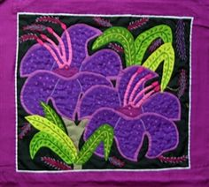 A purple flower mola, handstitched by the Kuna Indians in Panama. Molas look great framed or incorporated in a sewing project.