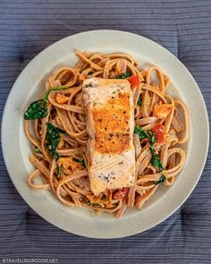 Creamy Salmon Pasta with Homemade Tomato Pasta Sauce || Love creamy pasta? Get a taste of Italy with this creamy salmon pasta with sun-dried tomato pesto sauce! Learn how to make salmon tagliatelle (or your choice of pasta noodles) on homemade pasta sauce with cream in 30 minutes. Check out this easy pasta recipe on Travelling Foodie. #travellingfoodie #recipes #easyrecipes #pastarecipes #creamypasta Salmon Pasta Recipes, Creamy Salmon Pasta, Creamy Tomato Pasta, Tomato Pesto, Easy Pasta Recipes, Pesto Pasta, Pesto Sauce, Pasta Noodles, Homemade Tomato Pasta Sauce