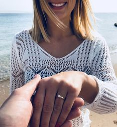 Cute engagement photo idea, engagement picture idea on the beach.