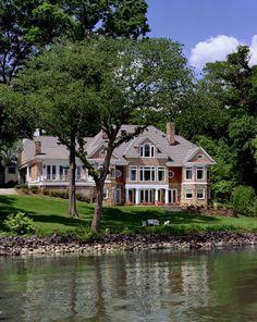 Shake, white trim, lots of windows. Oh yeah, the lake is pretty nice too. ;)