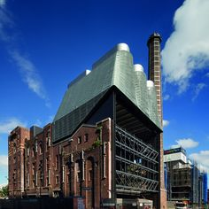 These three zinc-cloaked towers by Tzannes Associates form a power plant on the roof of an old beer brewery in Sydney