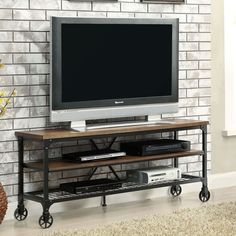 Furniture of America Carbon Loft Akroyd Industrial Medium Oak TV Stand (Medium Oak), Black Metal Tv Stand, Tv Stand Console, Diy Tv Stand, Console Tables, Center Console, Diy Man, Teal Cabinets, Industrial Tv Stand, Industrial Style