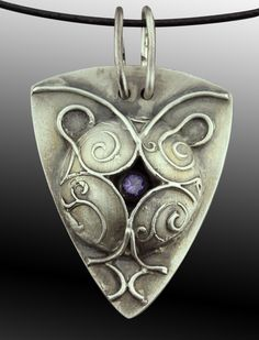 Sterling silver pendant from the new PMC Sterling Silver metal clay. Accents from syringe clay and a CZ.
