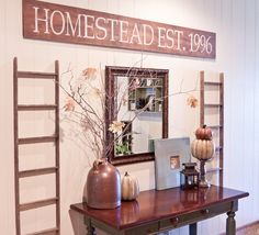 """I like the """"home established"""" sign, but would that be the year we married or the year we moved into our house? Hmmmm"""