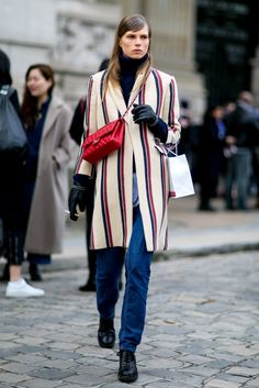 A Chanel bag paired with a striped coat.