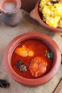 spicy Kerala style toddy shop fish curry.Kerala special red fish curry and mashed tapioca