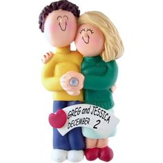 Engaged Couple Ornament - Brunette Male, Blonde Female.This ornament and many more can be found at https://www.ornaments.com