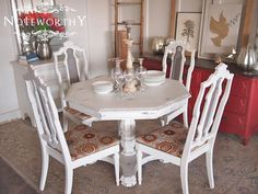 White Distressed Pedestal Table and Chairs by noteworthyhome, $600.00 round table, painted, custom, red and orange upholstery, breakfast table, fall colors, fall decor, antique painted dining set