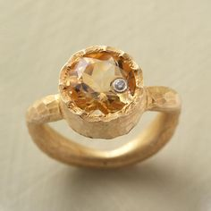 A tiny winking diamond is set into the sparkling surface of a faceted citrine framed in hand-hammered 22kt gold vermeil. Whole sizes 5 to 9....