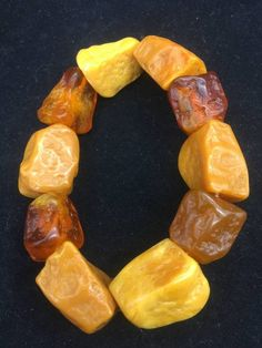 Chunky Baltic Amber Butterscotch Caramel Bracelet, Unisex, 22 mm beads Passes UV and salt water float tests. This is the most amazing set of beads, they are huge! Unusual Jewelry, Ethnic Jewelry, Glass Bead Game, Lalique Perfume Bottle, Amber Fossils, Baltic Amber Jewelry, African Beads, Amber Stone, Amber Necklace