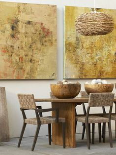 The Hermon & Hermon dining table and contemporary wall art brings warmth into this space.