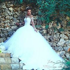 2017 New Arabic Ball Gown Wedding Dresses Illusion Long Sleeves Lace  Appliques Tulle Formal Bridal Gowns f3654ebcf674