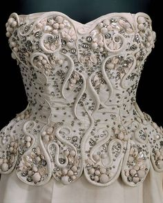 In Pretty Finery on FB 1949, Spain Evening dress by Cristóbal Balenciaga for Eisa Embroidery by Rébé, Paris Silk, plain weave (faille), appliquéd and embroidered with sequins, rhinestones, silk flowers, and silk-wrapped wire, with silk net and silk plain weave lining MFA Boston