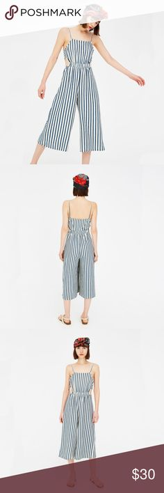 Pull&Bear striped midi jumpsuit Pull&Bear striped jumpsuit with side cutouts. Excellent pre-owned condition. Midi length. Machine washable, comfy knit fabric. Pull&Bear Dresses Midi
