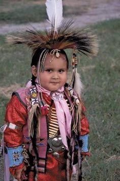 Native Child dressed in full Regalia