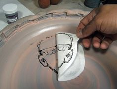 This simple paper-slip-transfer technique is a great way to add imagery to your pots.