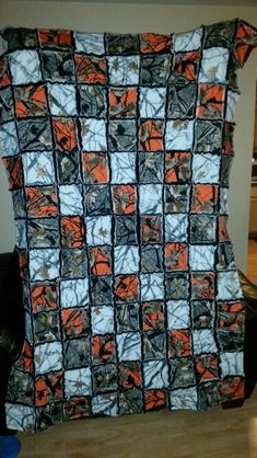Orange camo, real tree camo, snow camo lap sized rag quilt. Made out of sweatshirt material with fleece backing.