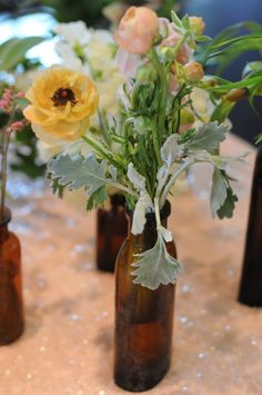 Dusty miller, citrus flowers, vintage-y vases: check, check, check