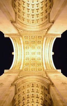 Arc de Triomphe Paris viewed from below at night