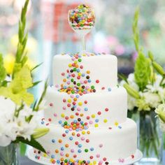 "Love the colorful candy ""waterfall"" accent & the wine glass filled with the candy on top!! What a simple, easy & fun cake!!!"