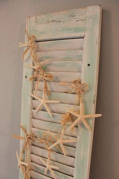 Old shutter dry brush paint with starfish garland