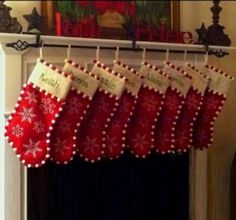 Three mantle setting stocking holders, a curtain rod…great way to hold multiple Christmas stockings!