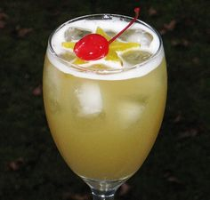 Leg Spreader    (2 oz. Captain Morgan Spiced Rum  2 oz. Peach Schnapps  2 oz. Malibu Coconut Rum  4 oz. Pineapple Juice  Star Fruit or Cherry to garnish)