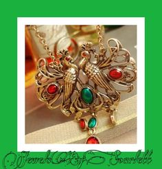 Love Birds     Beautiful Statement Necklace. Intricately decorated with red and green crystals in antique gold. #antiquegold #retro #red #green  etsy.com/shop/jewelsbyscarlett | Shop this product here: http://spreesy.com/JewelsByScarlett/62 | Shop all of our products at http://spreesy.com/JewelsByScarlett    | Pinterest selling powered by Spreesy.com