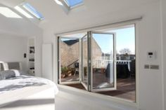 White framed #bifoldingdoors installed to a residential refurbishment in #London