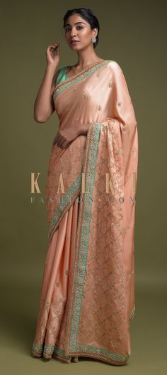 Buy Online from the link below. We ship worldwide (Free Shipping over US$100)  Click Anywhere to Tag Melon-Peach-Saree-In-Satin-With-Zari-Embroidered-Moroccan-Pattern-And-Floral-Buttis-Online-Kalki-Fashion Bridal Sarees, Wedding Sarees, Peach Saree, Moroccan Pattern, Indian Style, Indian Fashion, Sari, Free Shipping, Link