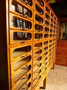 Haberdashery cabinet with 66 glass Fronted drawers and brass handles (50s or 60s)