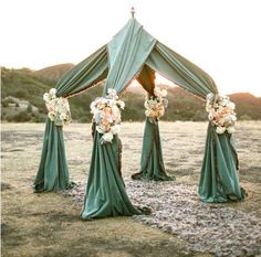 You could use a Pop Up Tent Frame and create some thing like this to get married under any where on the lawn. Think blue cloth/ pink flowers