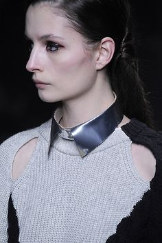Philip Lim FW 2012 collection.  I like the open detail at the shoulders and the metal collar necklace.